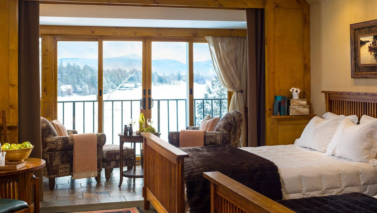 Two queen beds with view of lake