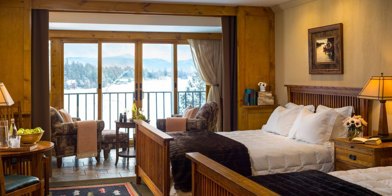 Two queen size beds with view of lake