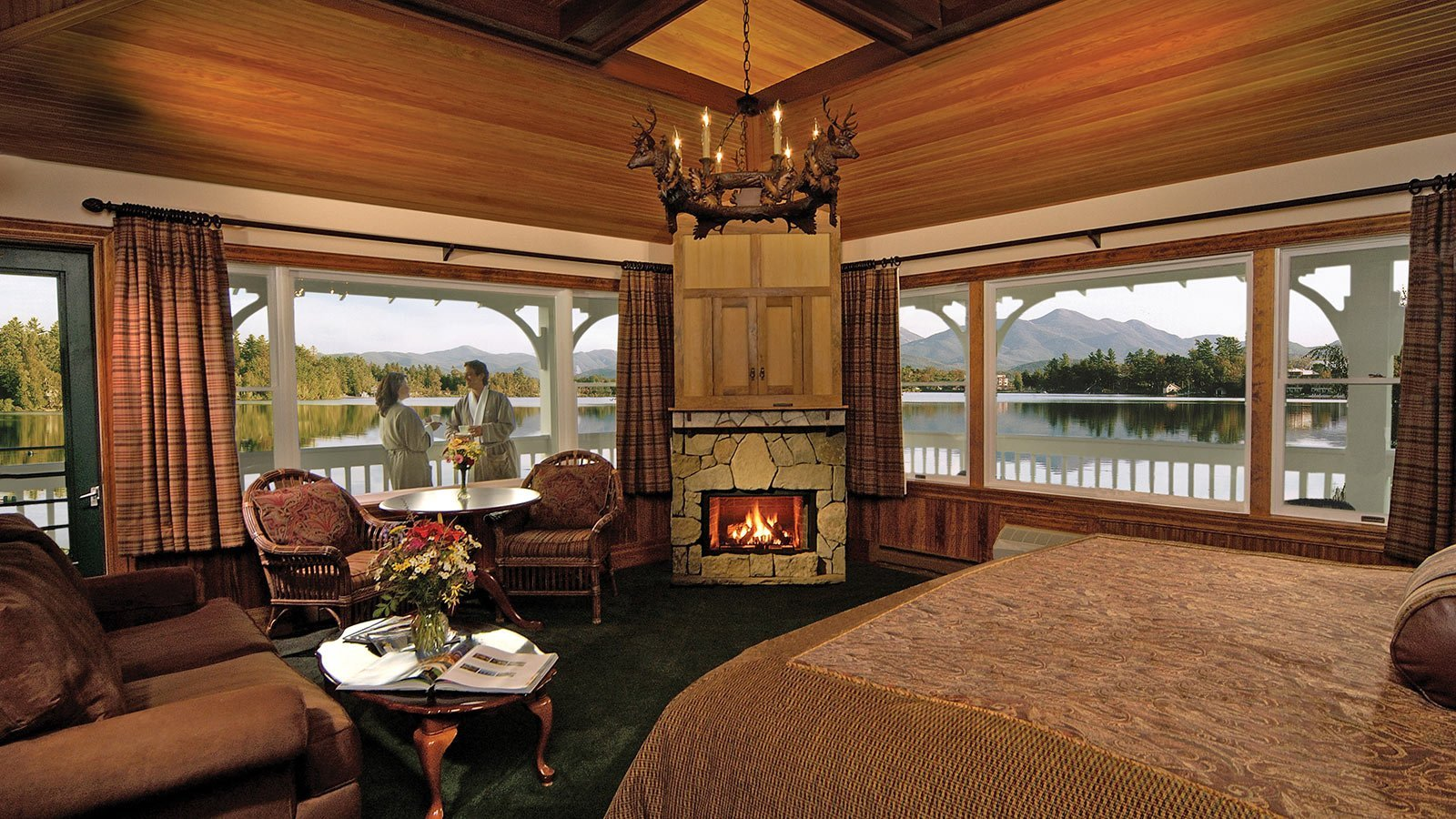 Main room with large windows and a view of the lake and mountains