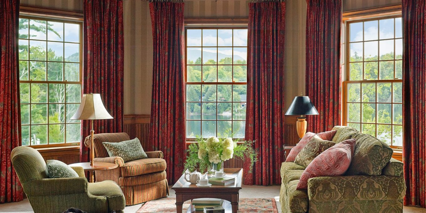 Sitting room with sofas and tall windows
