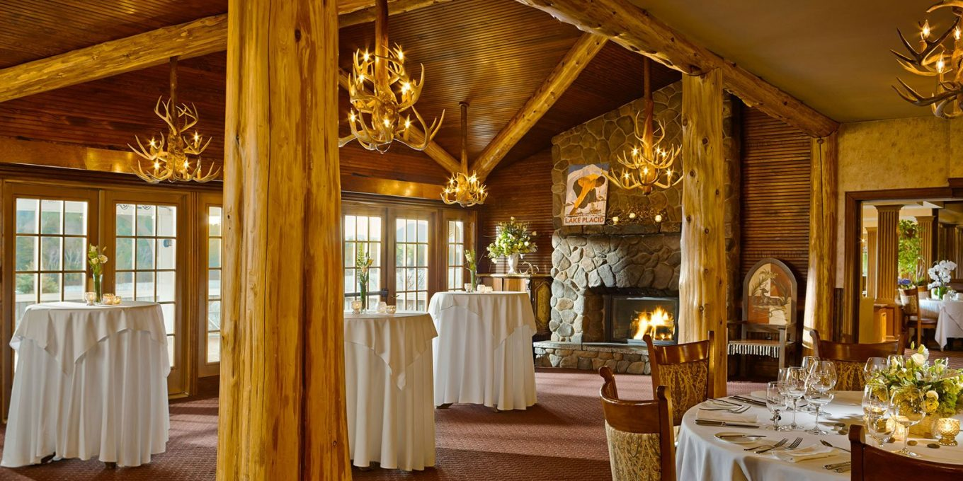 Dining room with a fireplace and chandeliers