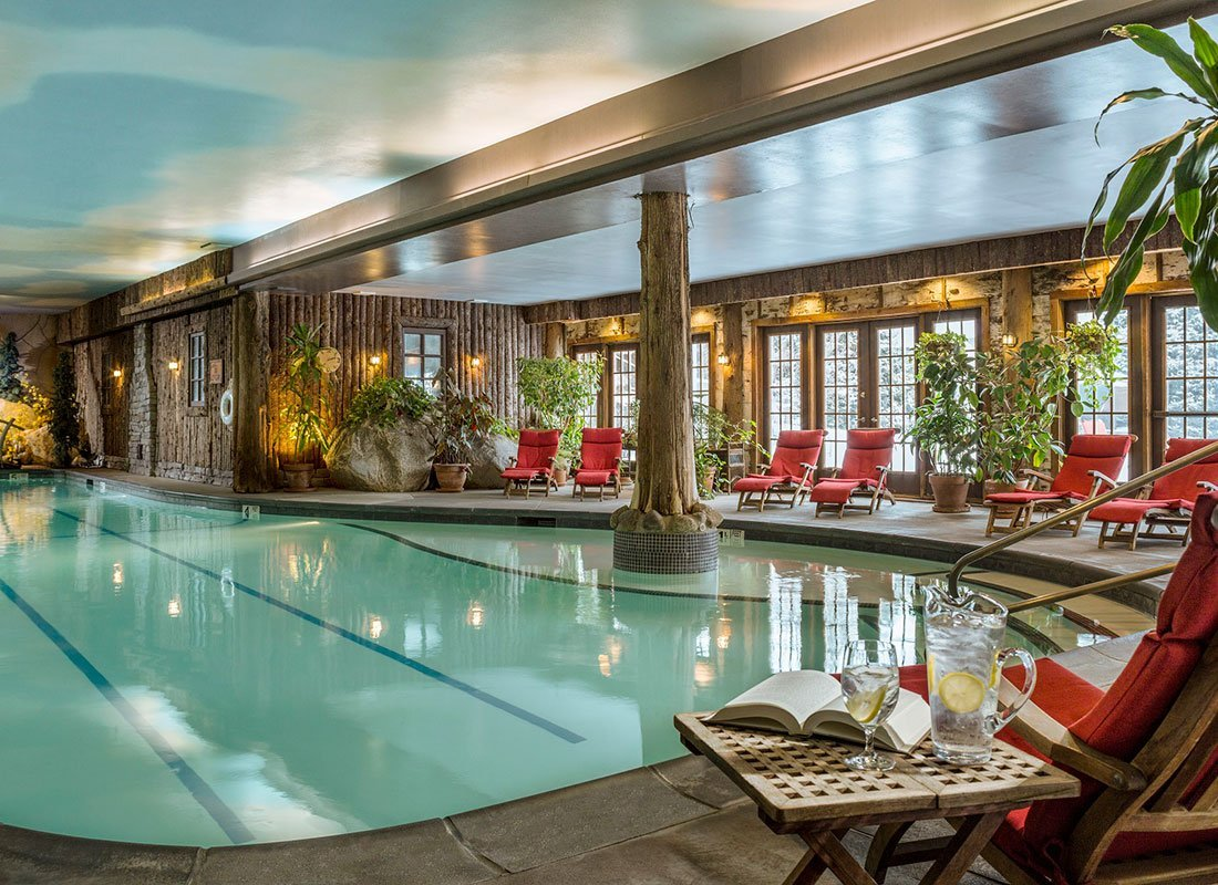 Calm indoor pool with seating around