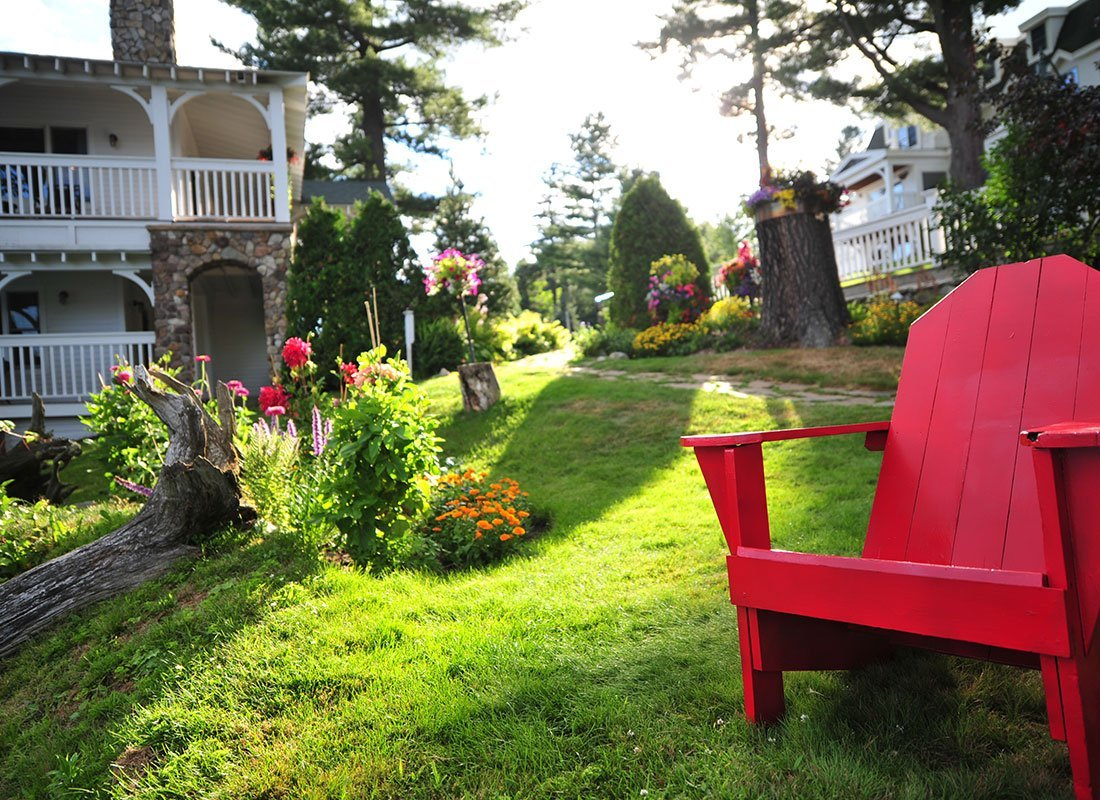 Adirondack chair with hotel and grounds in background