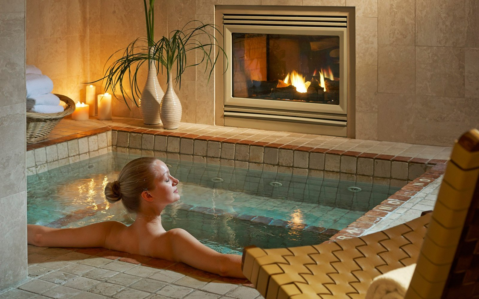 Woman relaxing in the indoor spa hot tub