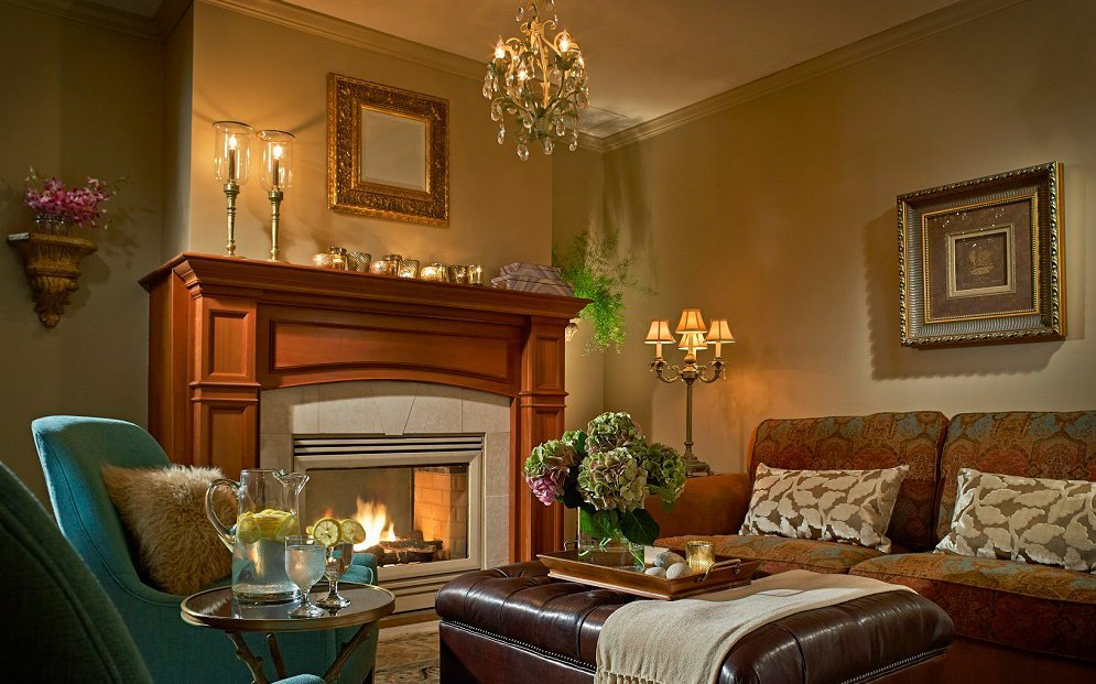Spa parlor with couches, chairs next to a fireplace