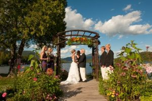 Outdoor wedding in front of lake