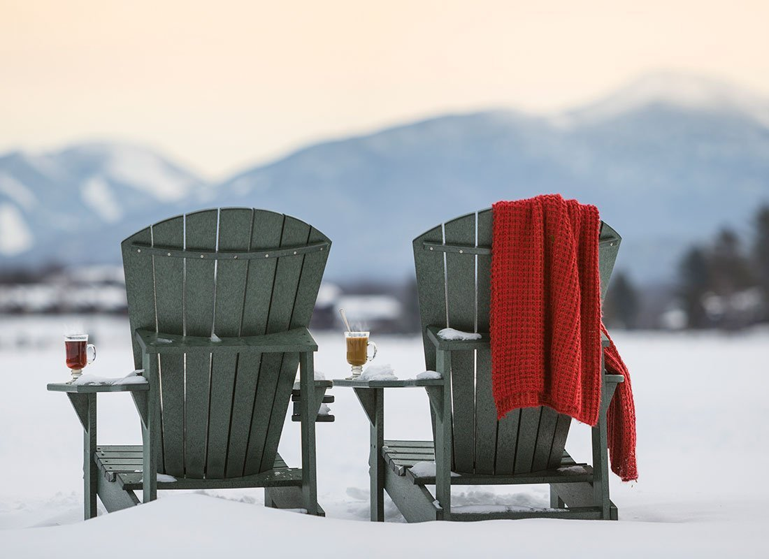 Adirondack chairs in the snow