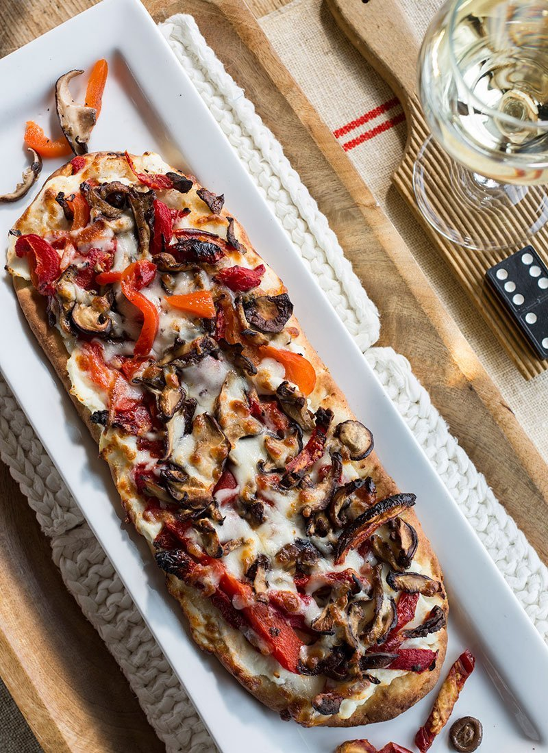 Flatbread on plate with wine
