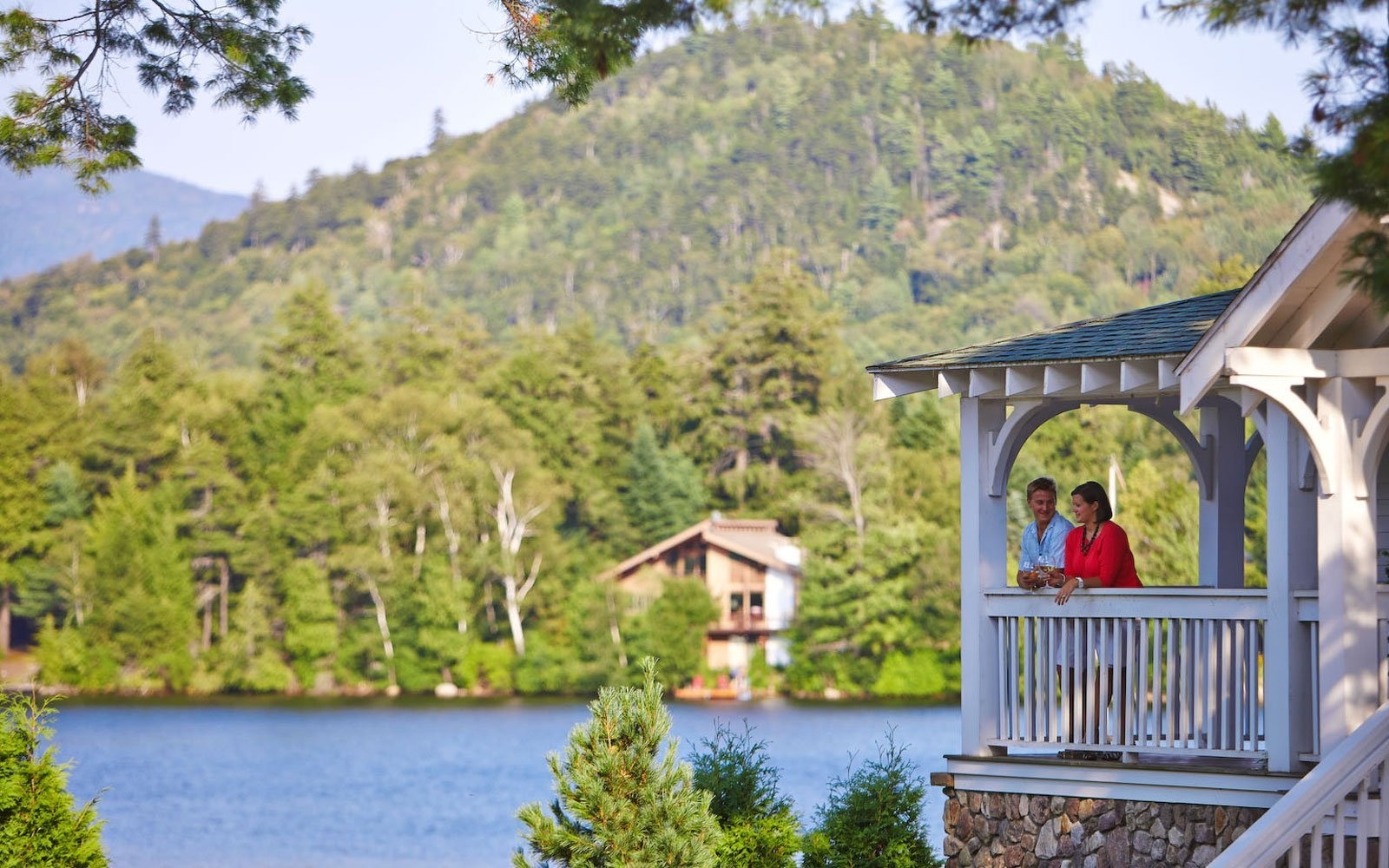 A couple standing on patio near the lake