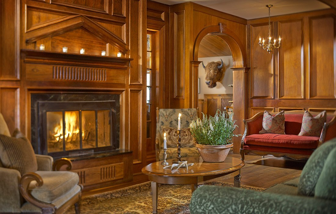 Interior view of Lounge by a fireplace