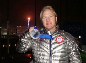 Andrew Weibrecht holding his Olympic medal from Sochi, Russia, 2014.