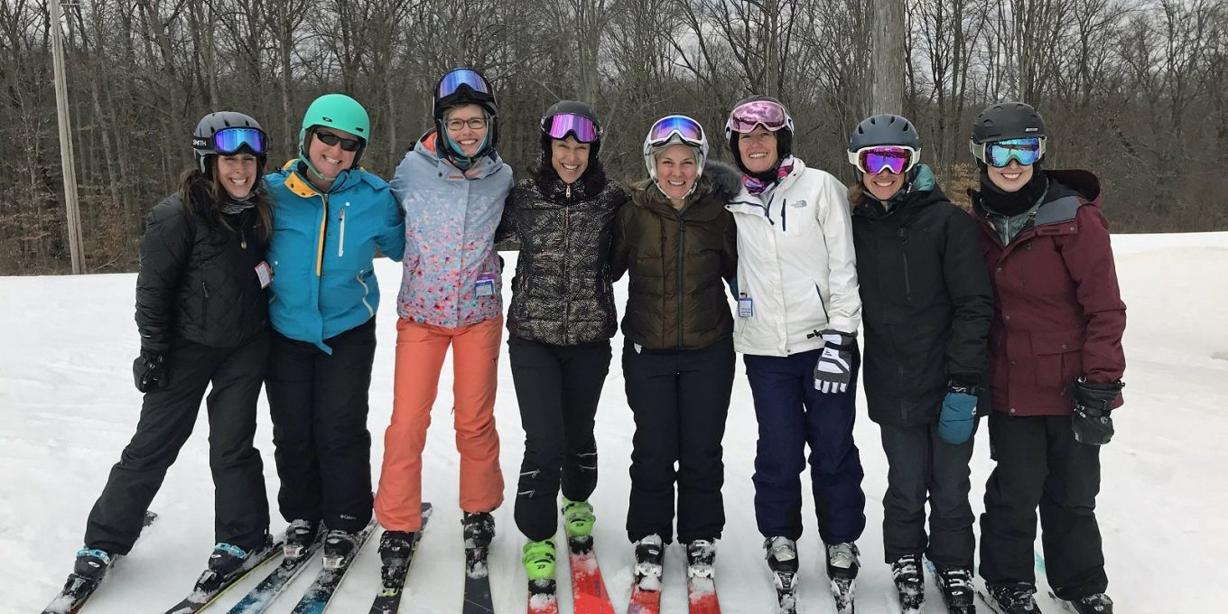 Women skiers posing for picture