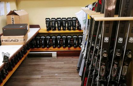 Ski Room with skis, poles and boots