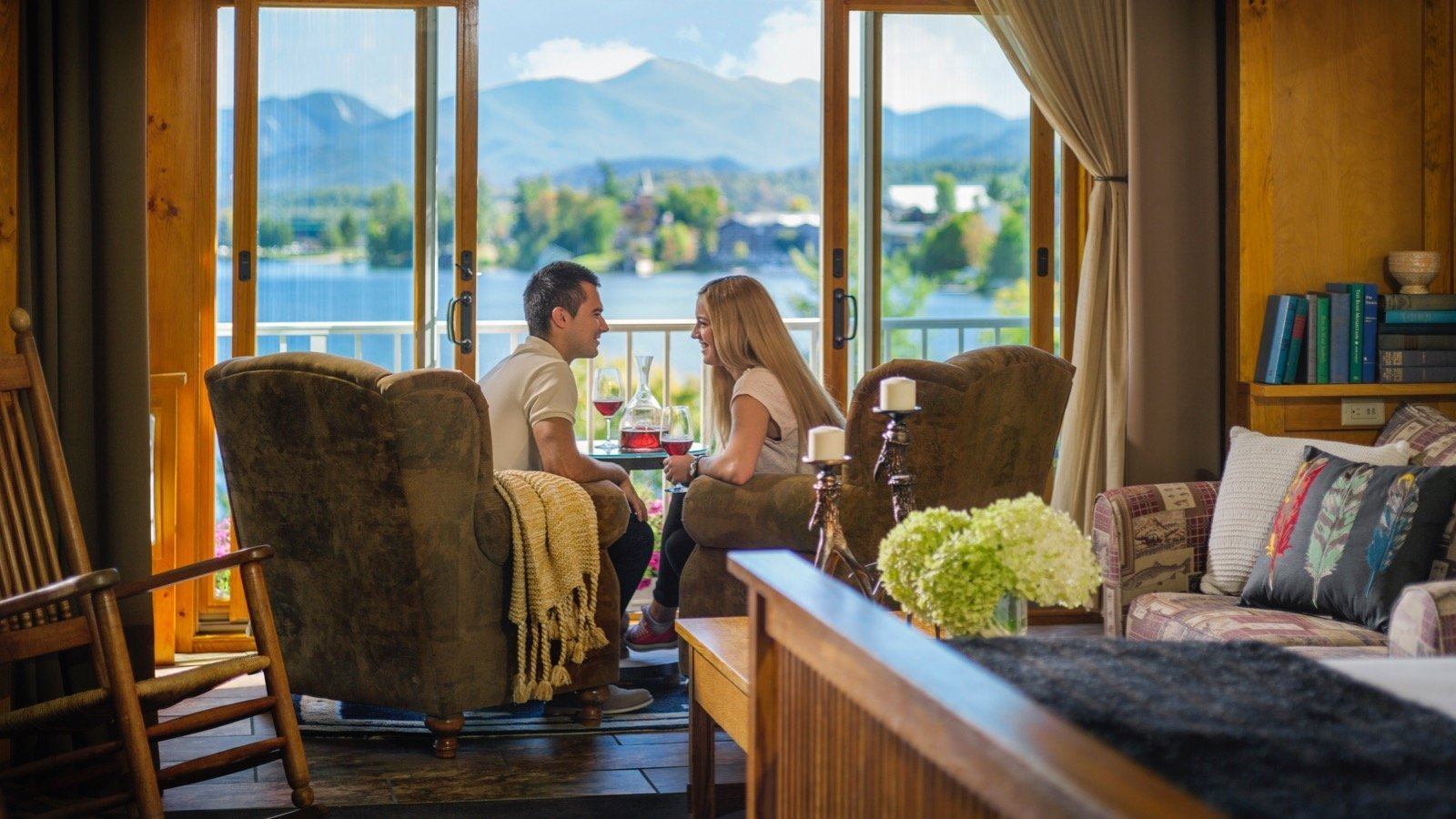 Couple sharing a drink in a room near the patio doors