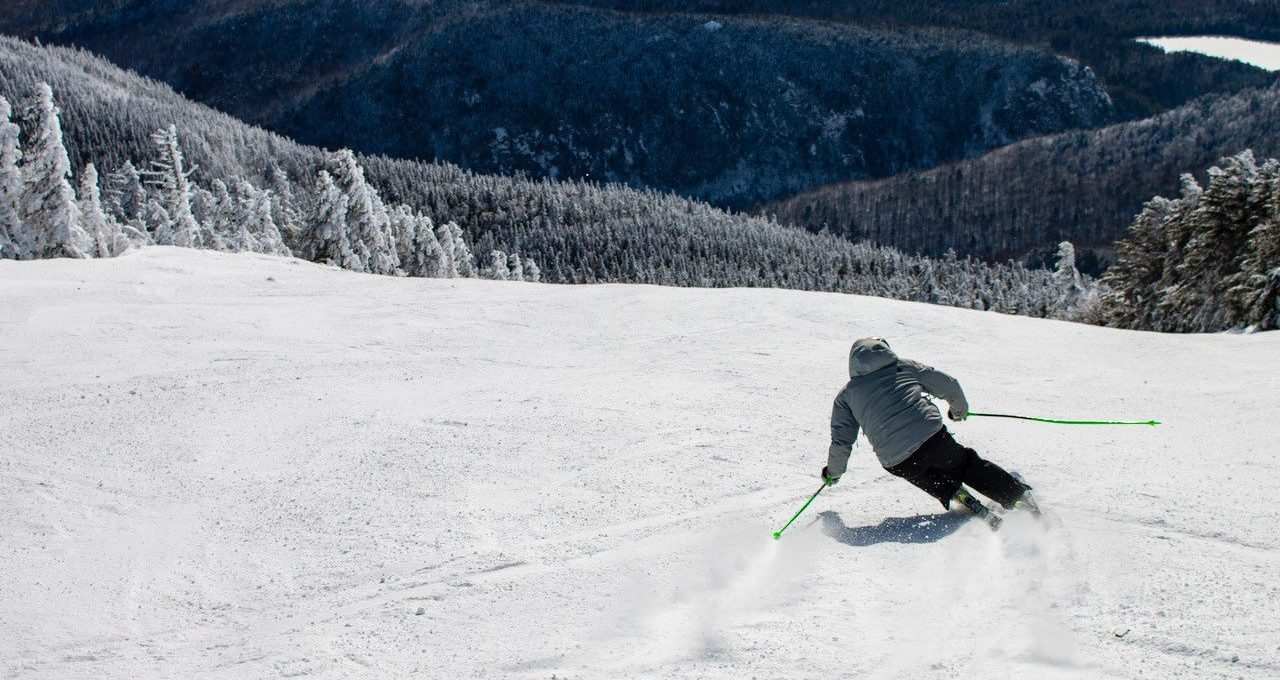 Man making a fast turn while downhill skiing