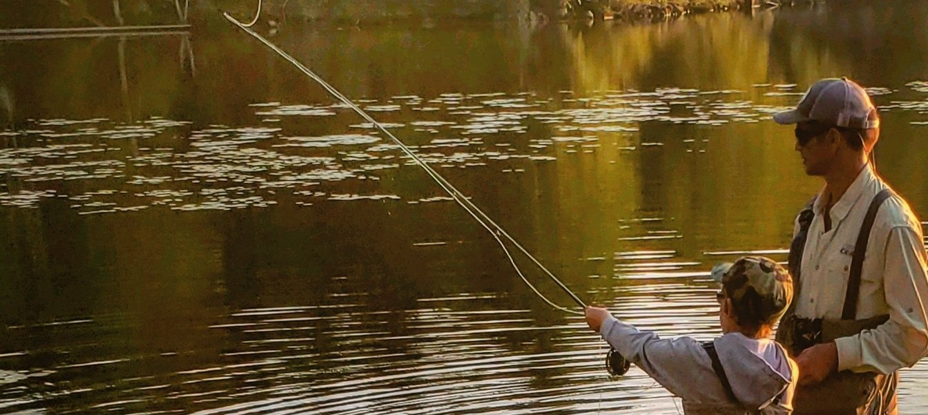 Father and son fly fishing
