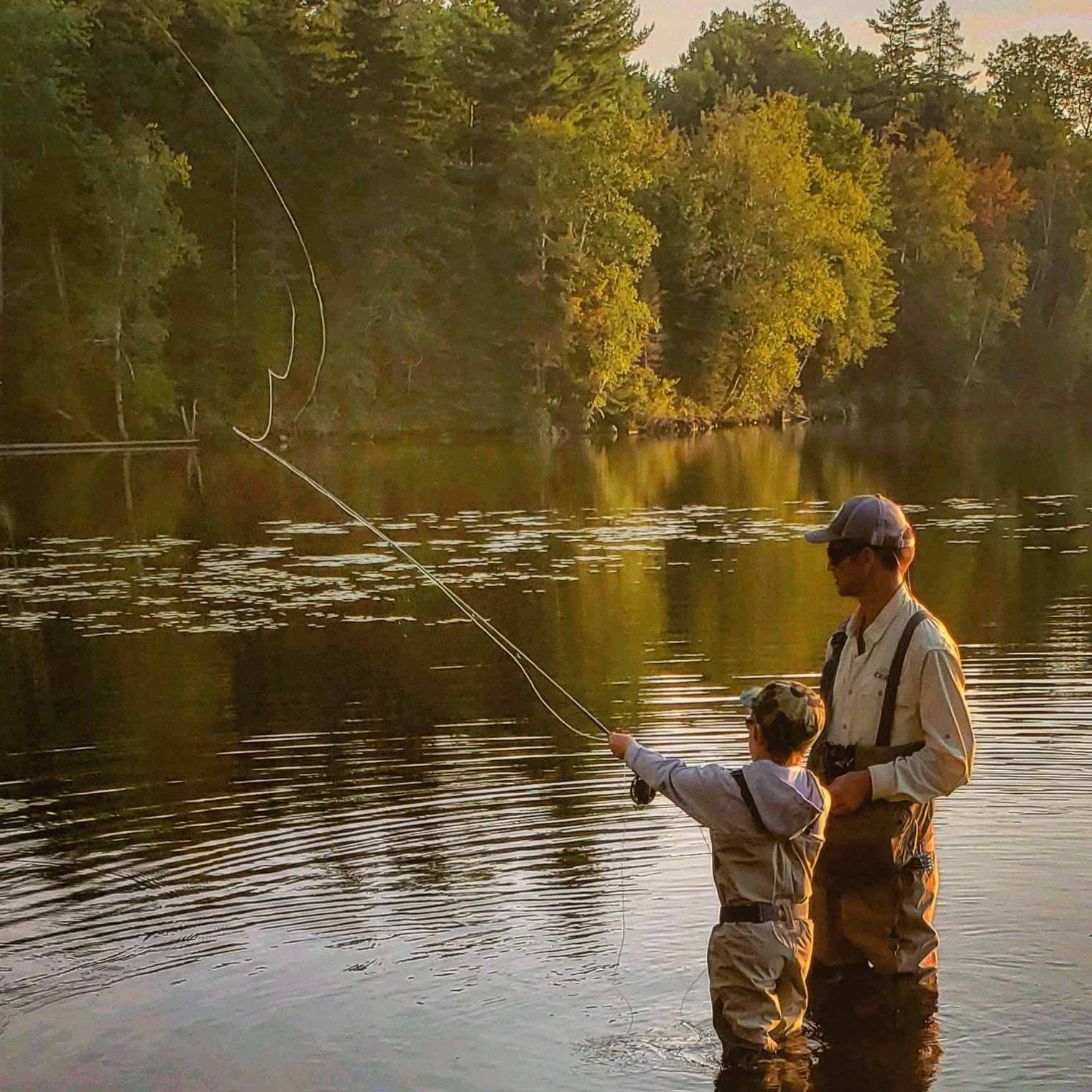 Father and Son Fly Fishing during the morning