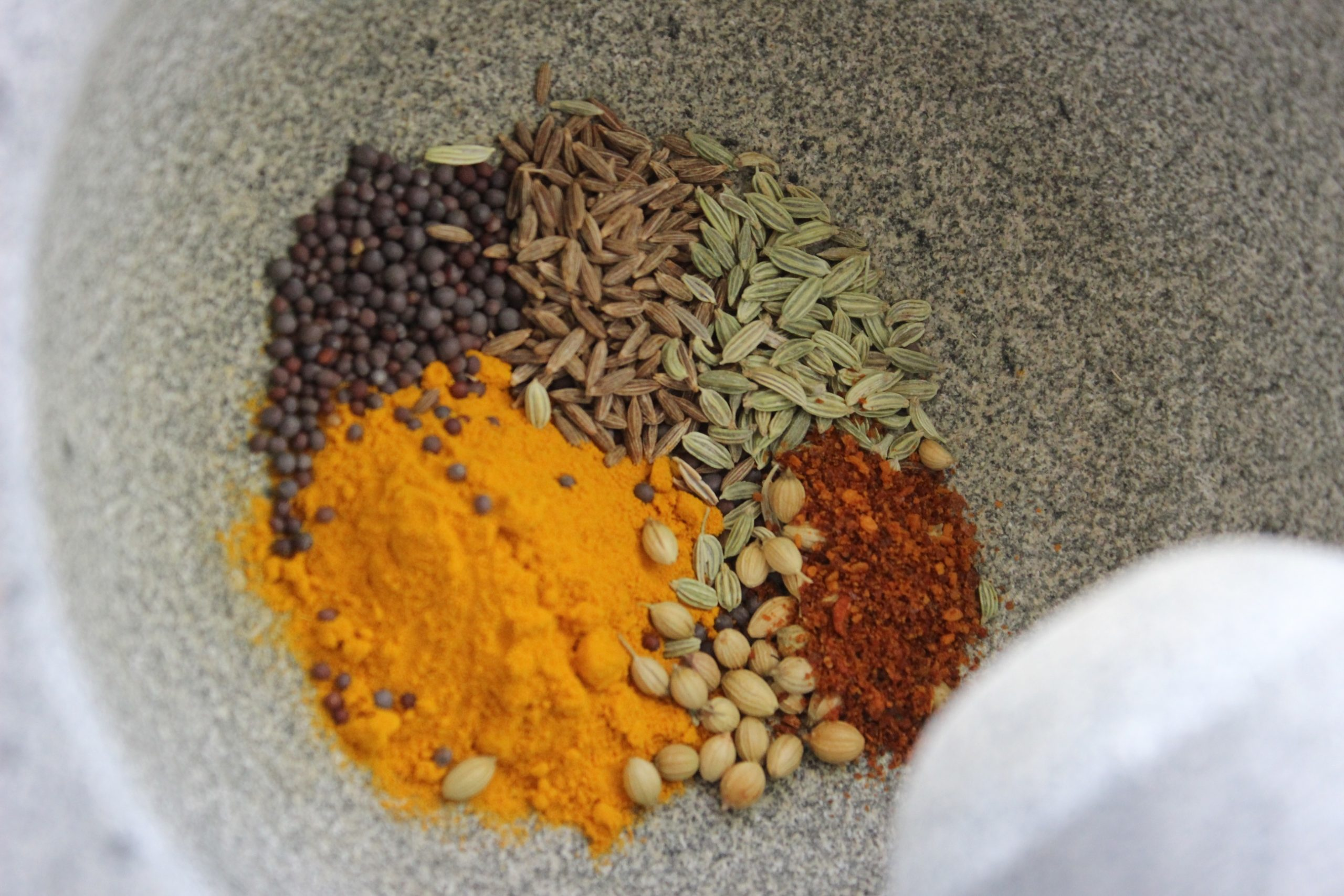 Multiple dry spices in a motar bowl