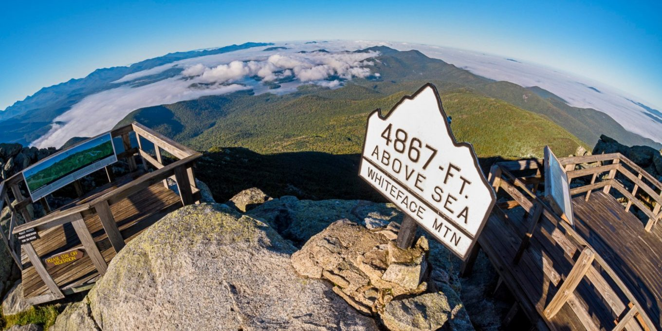 Aerial view of Whiteface Mountain summit signage which reads 4867 Ft above sea