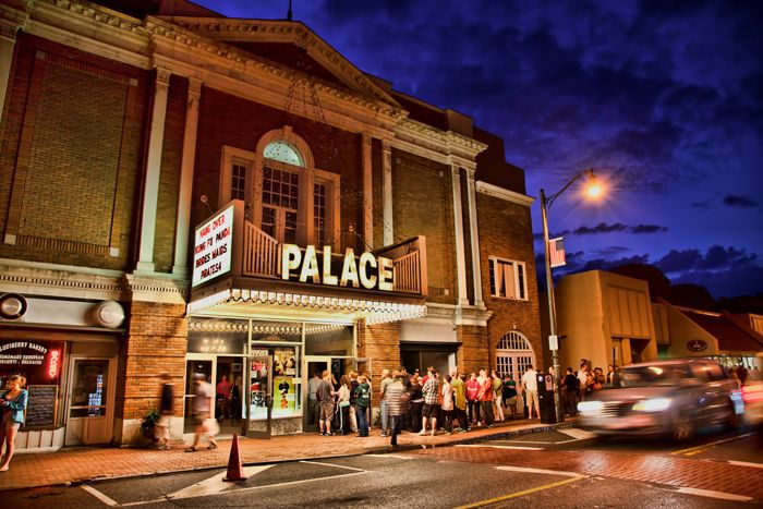 Lineup outside of 'Palace' Movie Theater at night