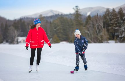 Woman skating beside her son on Mirror Lake