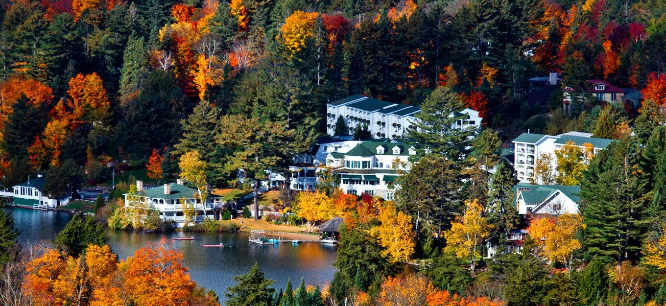 Aerial view of Mirror Lake Inn surrounded by trees in fall colours
