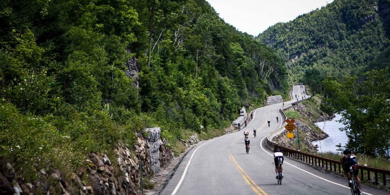Bikers during an Ironman race on paved road