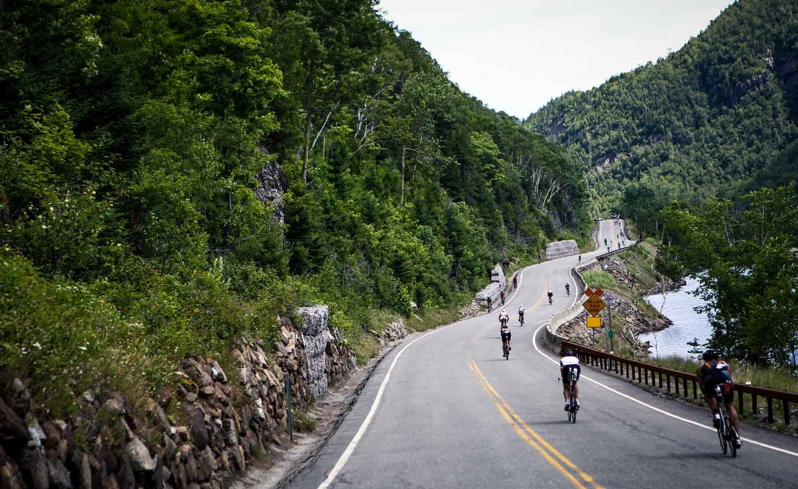 Bikers during an Ironman race on paved road.