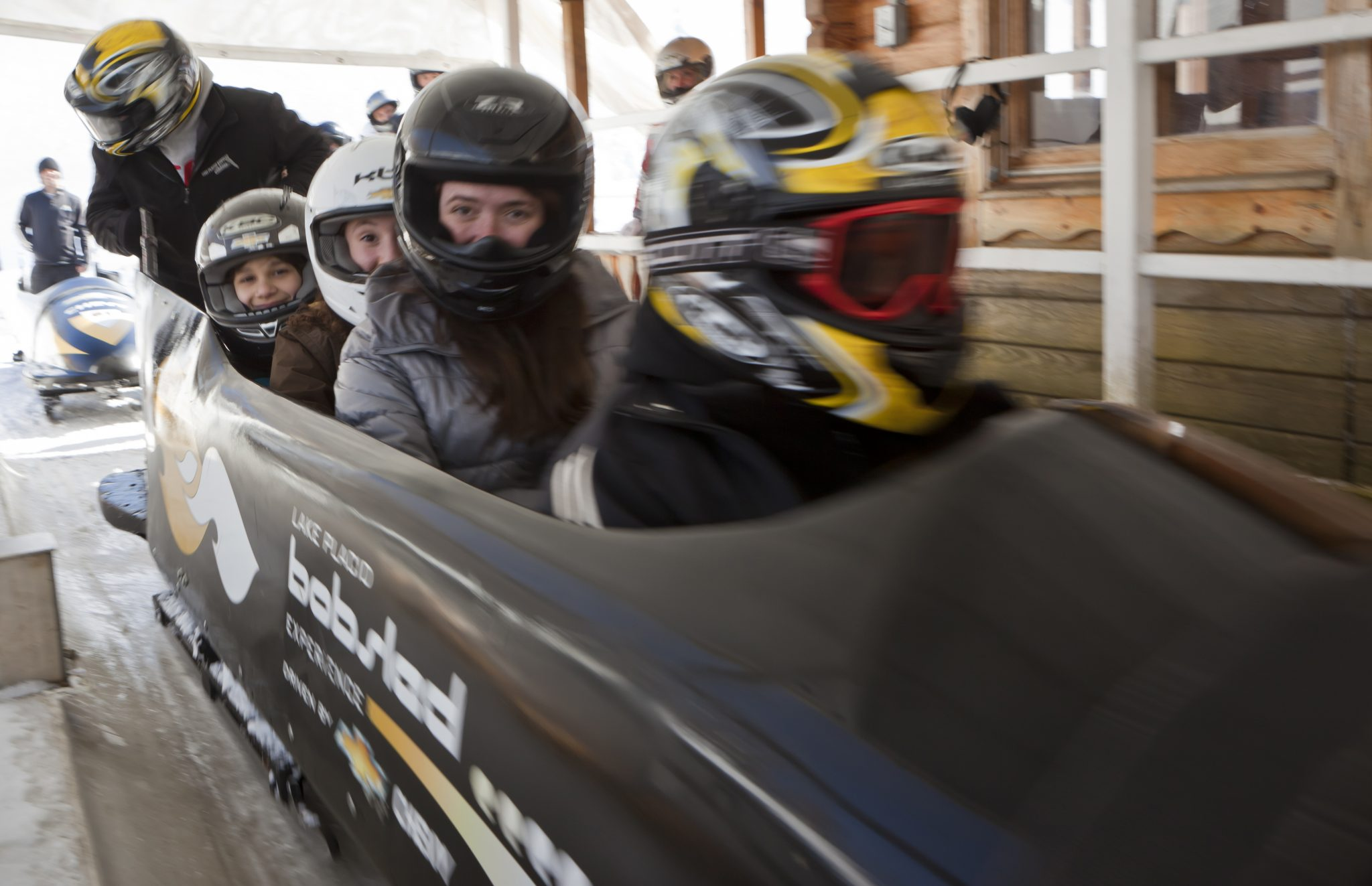 Four children in a bobsled.