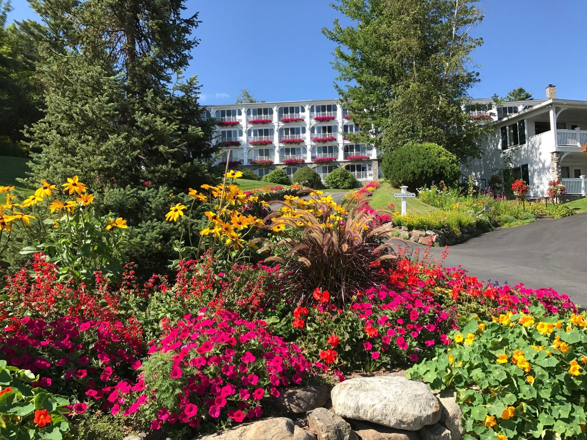 Array of red and yellow flowers outside Mirror Lake Inn Resort & Spa