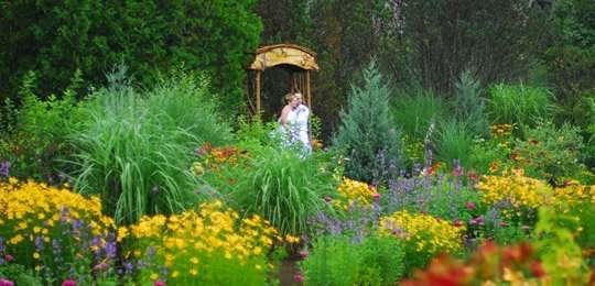 Bride and Groom standing in wedding gardens