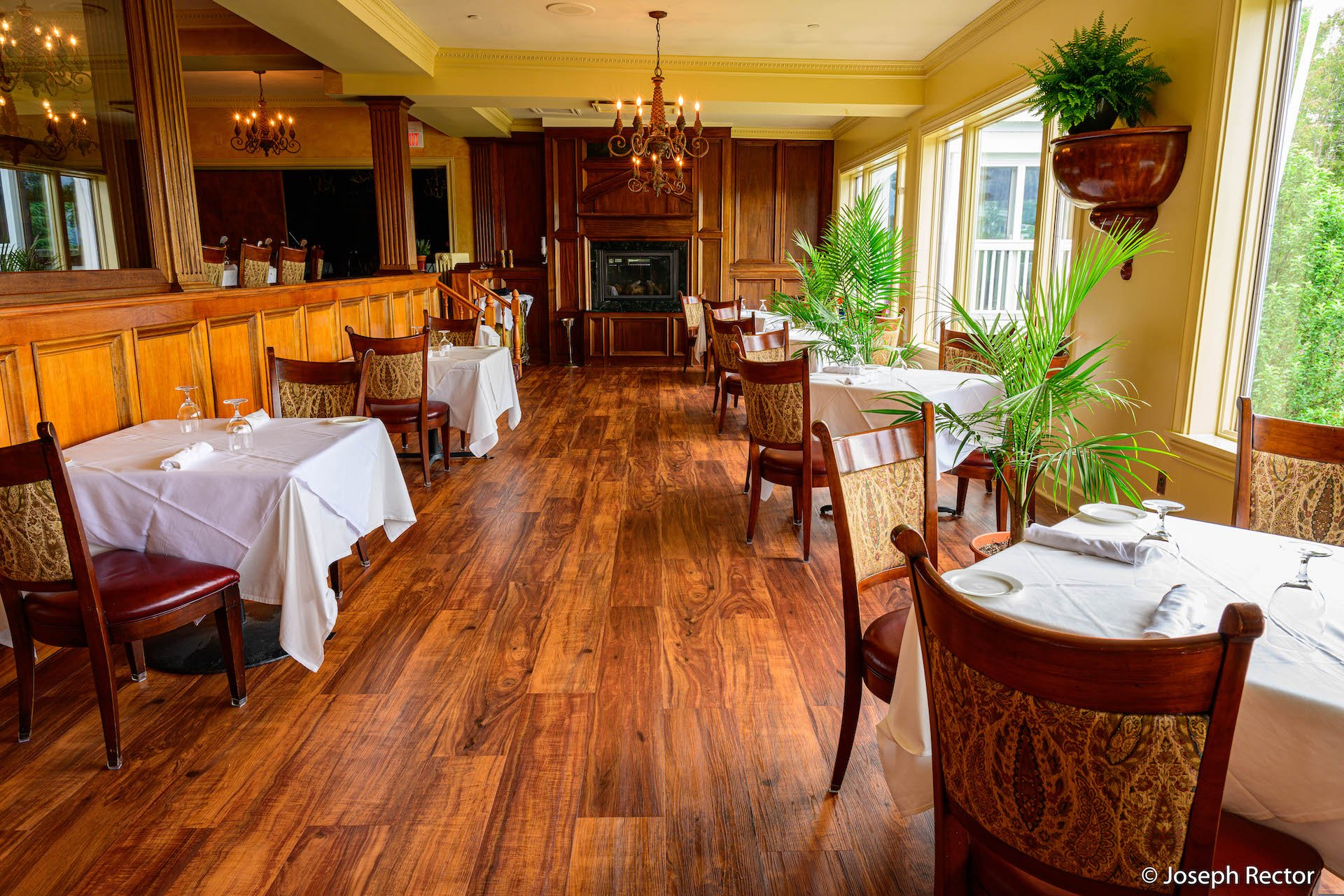 A bright dining room with wood floor and panelling at The View restaurant