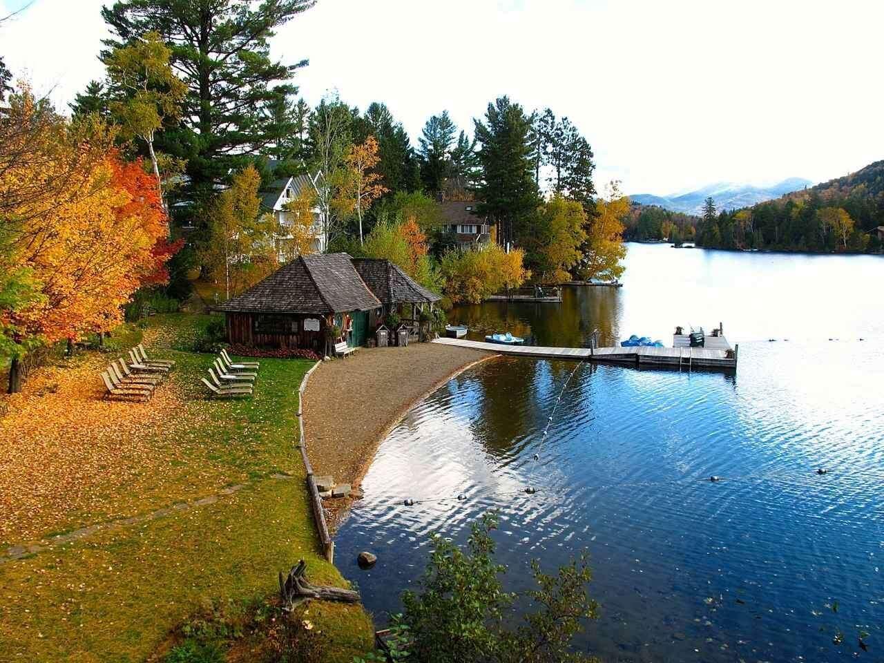 Mirror Lake Inn's private beach in fall