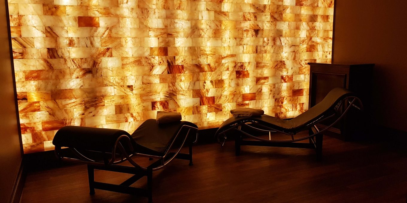 Two reclining chairs next to a glowing salt therapy wall