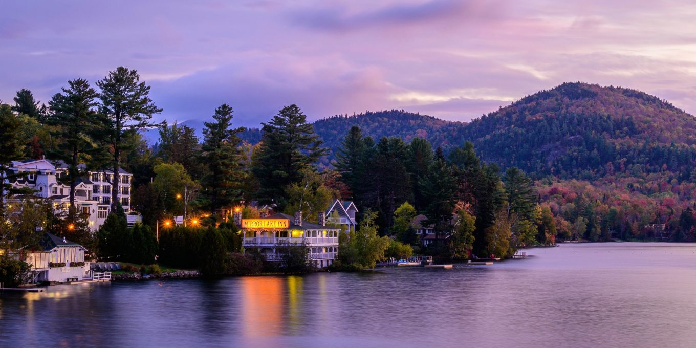 Photo of the Mirror Lake inn at dusk from across the lake