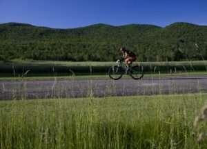 A biker rides in Lake Placid