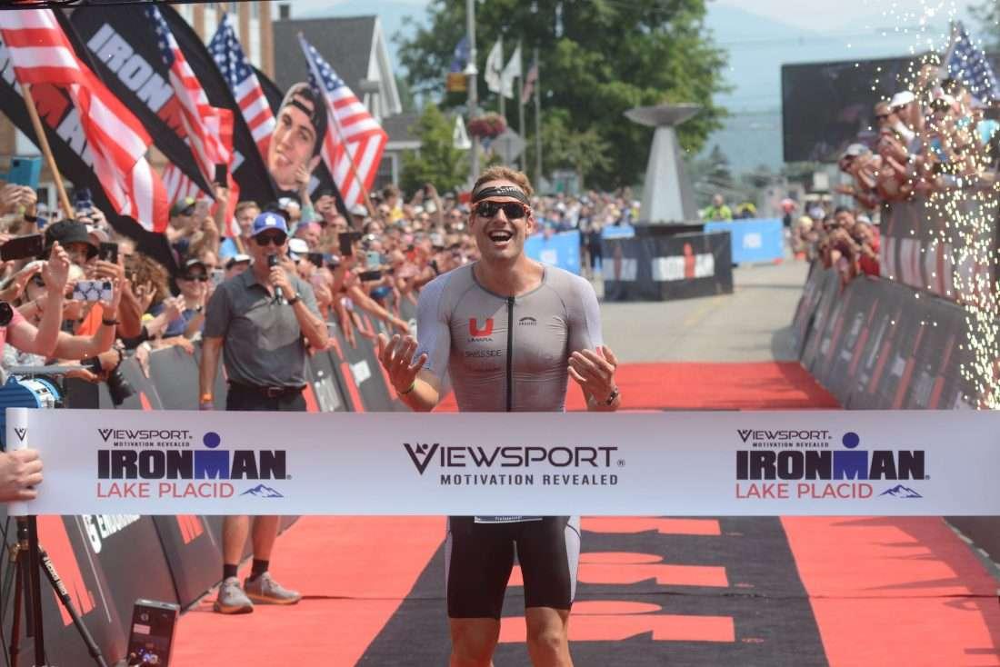 Triathlete crosses finish line